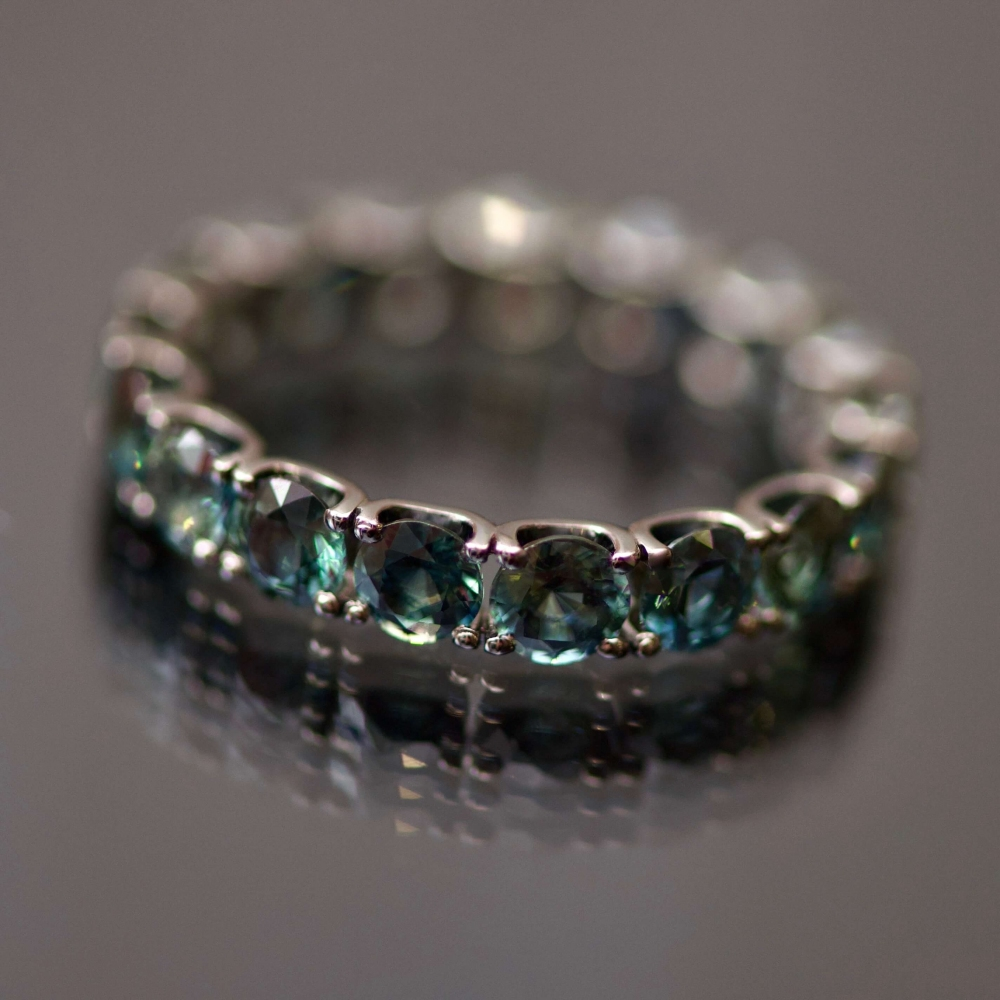 Infinity ring with marriage sapphires in black gold